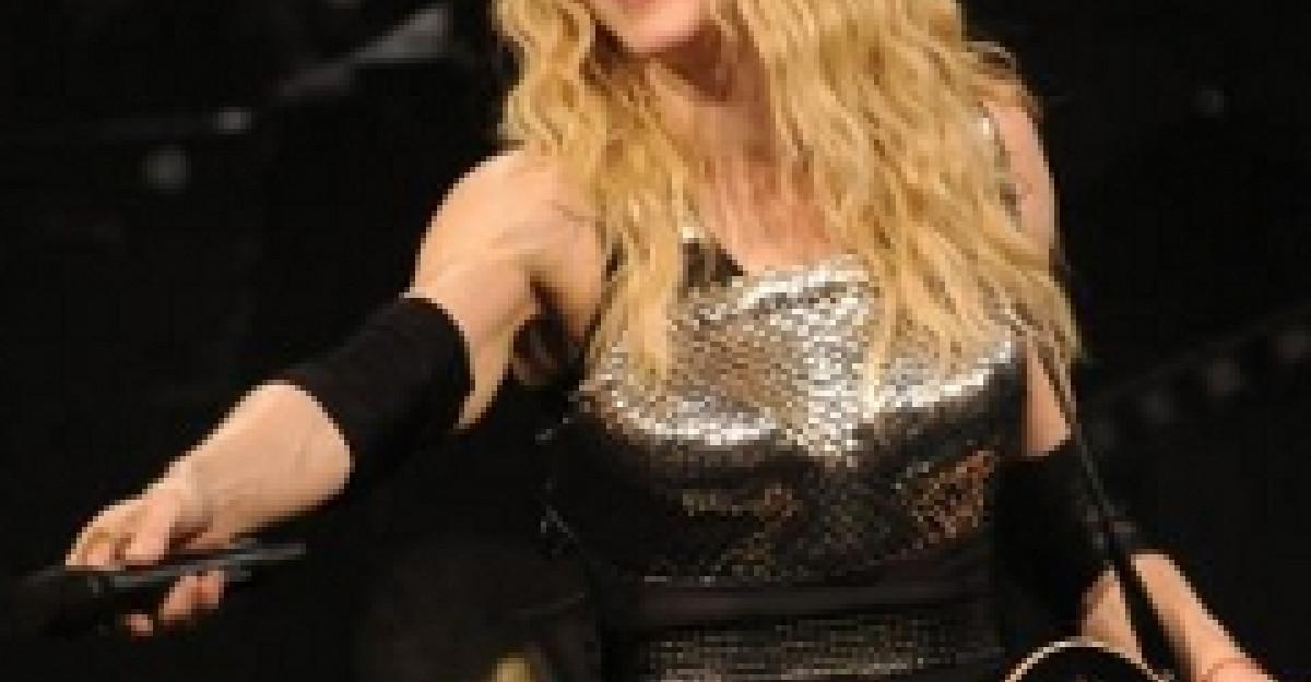 De ce a ajuns Madonna cu buza umflata?