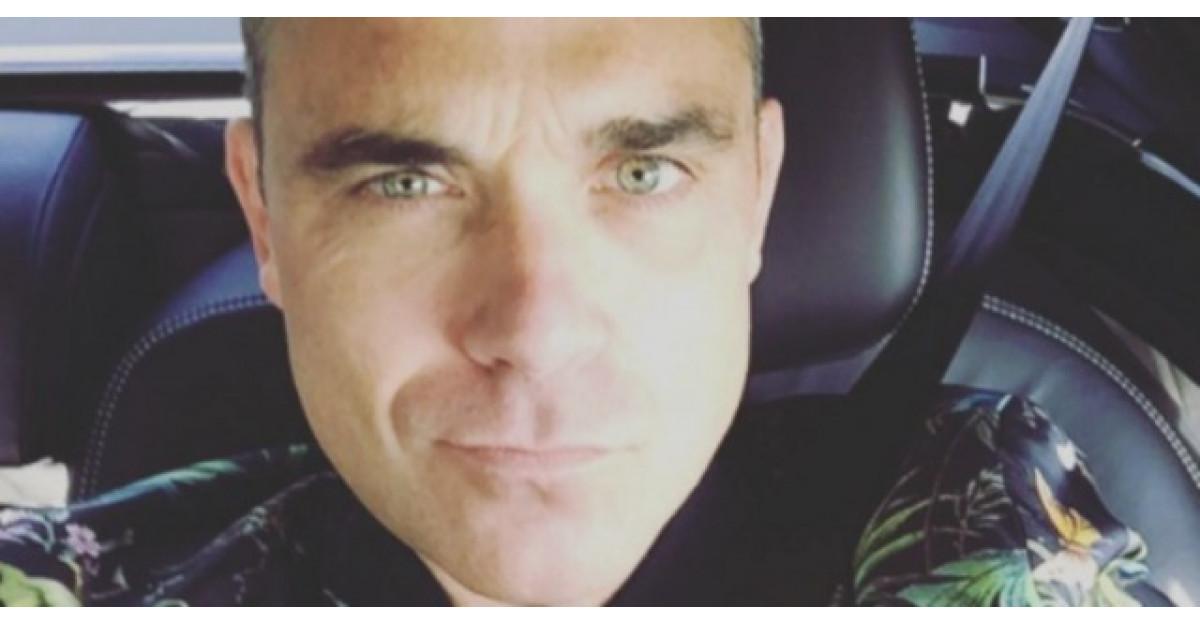 Robbie Williams rade de Romania intr-un filmulet oficial