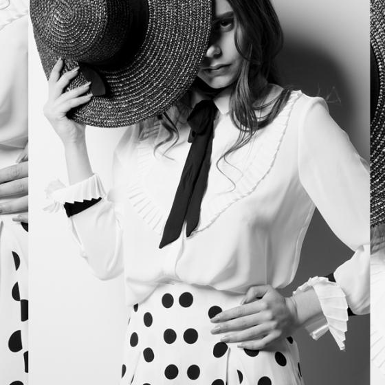 Cum porți fusta cu buline la birou: un look retro-feminin, de efect