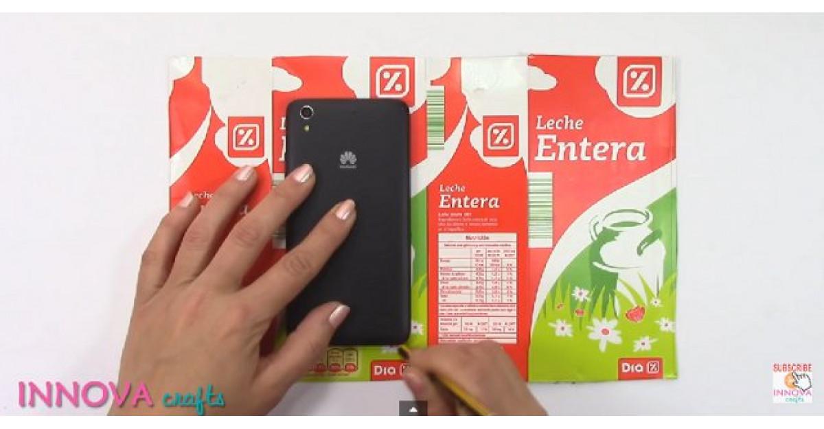 Video: Taie o cutie de lapte dupa forma telefonului. Ce face apoi? NU POT SA CRED