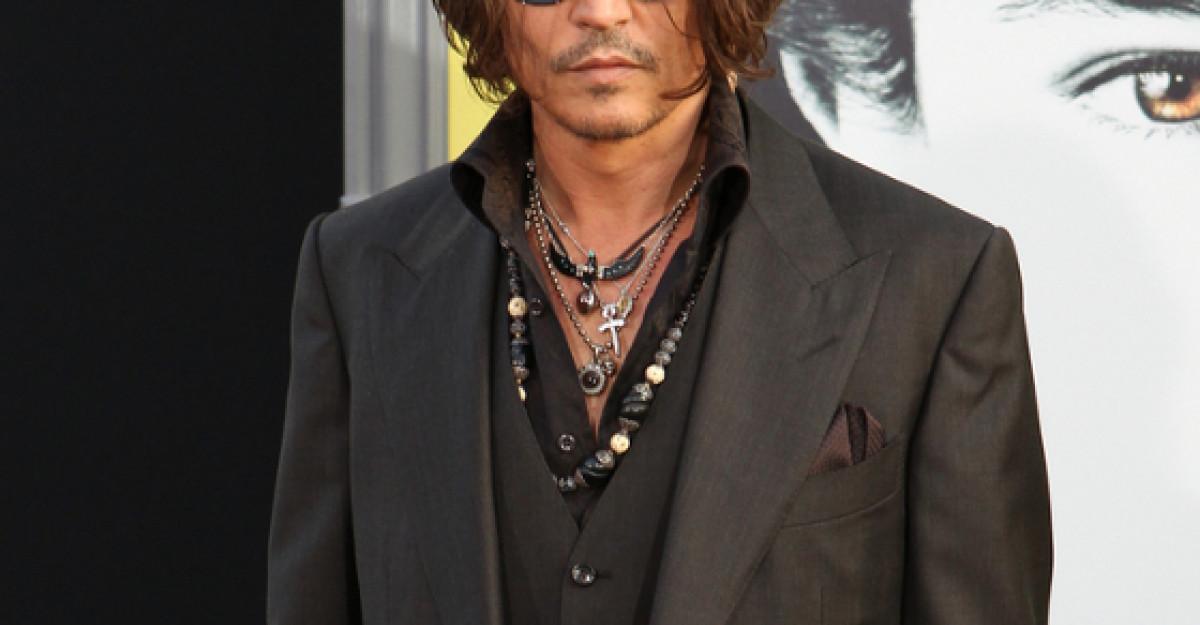 Johnny Depp, parasit de iubita pentru o femeie!